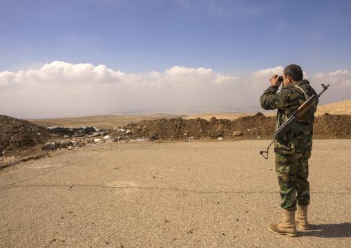 Kurdish Peshmerga Looking With Binoculars On The Frontline, Duhok, Kurdistan, Iraq
