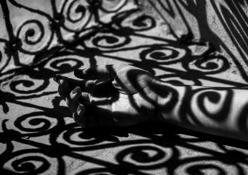 Woman Hand In The Shadow Of A Wrought Iron Window In The Citadel, Erbil, Kurdistan, Iraq