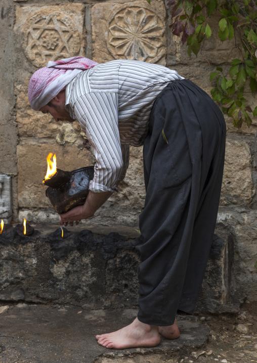 Yezedi Fakirs Lighting Sacred Fire In The Streets,  In Lalesh Temple, Kurdistan, Iraq