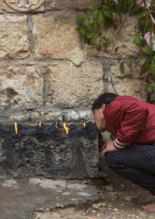 Yezedi Man Kissing The Sacred Fire, Lalesh Temple, Kurdistan, Iraq