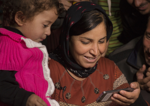 Yezedi Refugees From Sinjar Making A Conference On A Mobile Phone With Relatives, Zohar, Kurdistan, Iraq