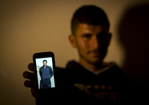 Yezedi Refugee From Sinjar Showing A Relative Killed By Daesh On His Mobile Phone, Zohar, Kurdistan, Iraq