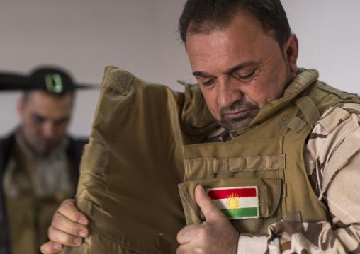 Kurdish Peshmerga On The Frontline Putting A Bulletproof Jacket, Duhok, Kurdistan, Iraq