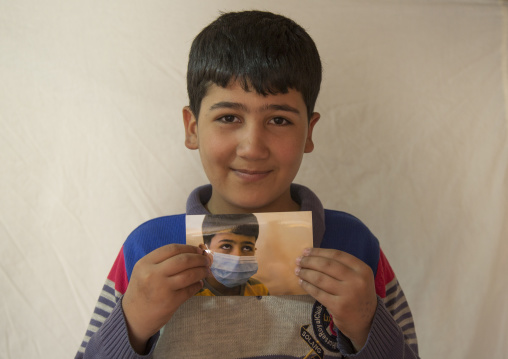 Elias, A Syrian Refugee In Qushtapa Refugee Camp Holding A Picture Of Himselgf When He Was Ill, Erbil, Kurdistan, Iraq