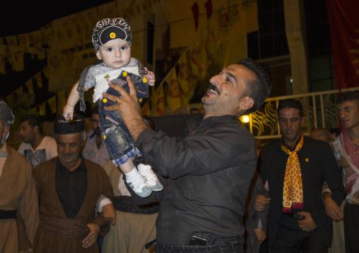 Man Holding His Baby During A Kdp Meeting, Suleymanyah, Kurdistan, Iraq