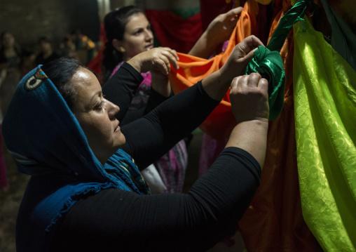 Yazidi Women Making Knots Inside The Temple City Of Lalesh, Kurdistan, Iraq