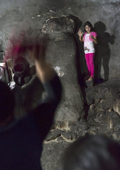 Yazidi Woman Throwing Scarf On Sacred Stone, Temple City Of Lalesh, Kurdistan, Iraq