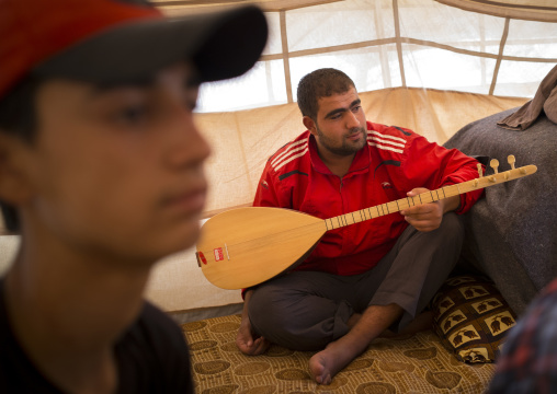 Syrian Refugee Playing Saz, Erbil, Kurdistan, Iraq