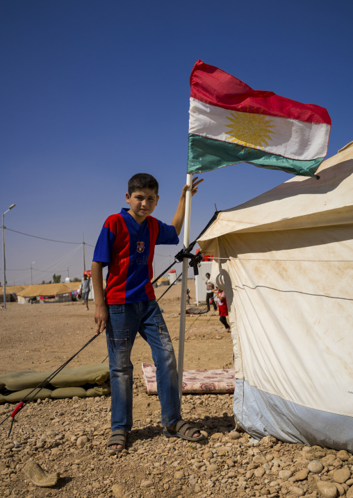 Syrian Refugee Child With A Barcelona Shirt In Front Of His Tent, Erbil, Kurdistan, Iraq