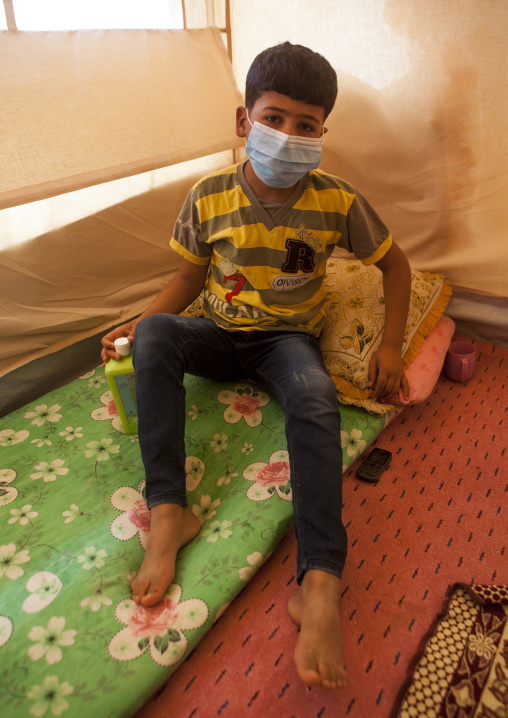 Ill Young Boy With A Mask In A Syrian Refugee Camp, Erbil, Kurdistan, Iraq