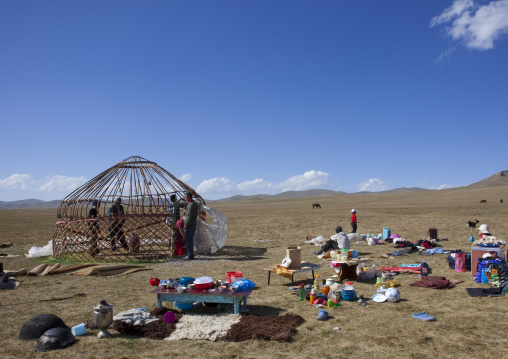 Family Putting Up A Yurt In The Steppe, Song Kol Lake Area,  Kyrgyzstan