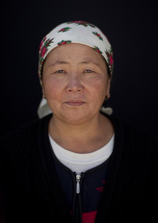 Woman Wearing A Headscarf In The Village Of Kyzart, Kyrgyzstan