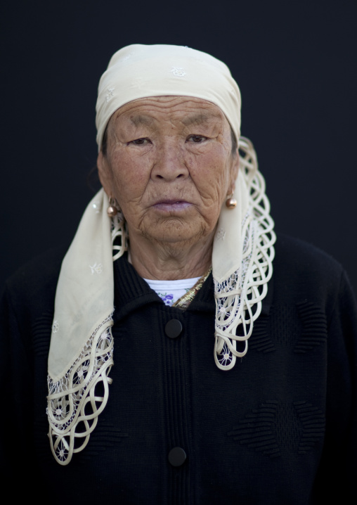 Old Woman Wearing A Headscarf At The Animal Market Of Kochkor, Kyrgyzstan