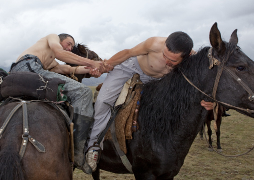 Men Doing Horse Wrestling In Saralasaz Jailoo, Kyrgyzstan