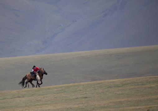 Horsemen Pulling On A Goat Carcass During A Horse Game, Saralasaz Jailoo, Kyrgyzstan