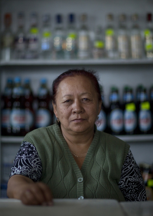 Old Woman Behind The Counter Of Her Store, Kochkor, Kyrgyzstan