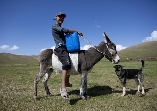 Boy With A Jerrycan On A Donkey, Jaman Echki Jailoo Village, Song Kol Lake Area, Kyrgyzstan