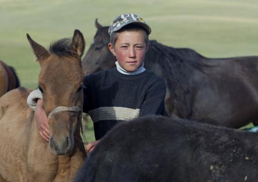 Boy In The Middle Of Colts, Jaman Echki Jailoo Village, Song Kol Lake Area, Kyrgyzstan