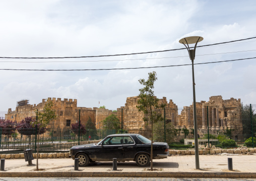 Car parked in front of the antique ruins at the archeological site, Beqaa Governorate, Baalbek, Lebanon
