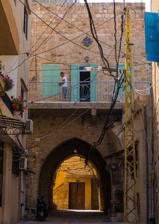 Lebanese man on the balcony of his traditonal house in the old city, South Governorate, Tyre, Lebanon