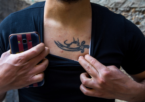 Ashura tattoo on the chest of a lebanese man, South Governorate, Tyre, Lebanon
