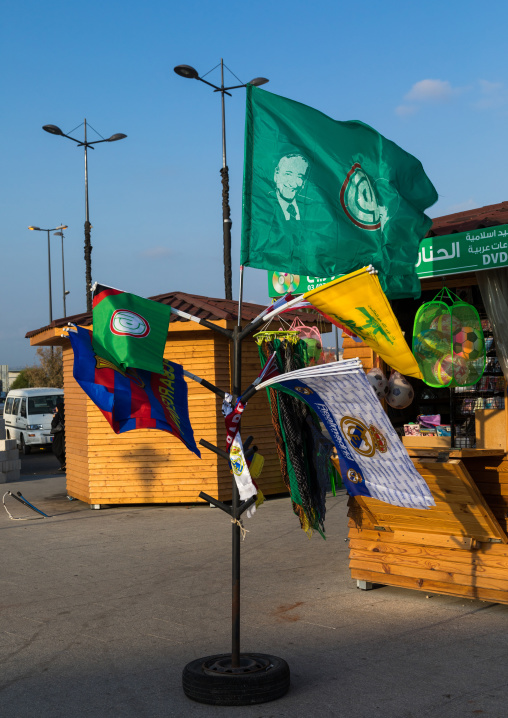 Flags with Hezbollah logo for sale with Barcelona and Madrid ones as tourist souvenirs, South Governorate, Tyre, Lebanon