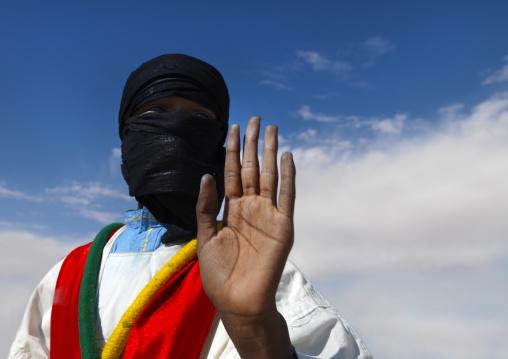 Tuareg man waving his hand, Tripolitania, Ghadames, Libya