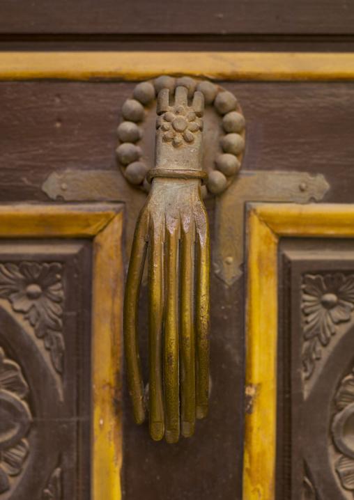Old italian knocker with a human hand, Cyrenaica, Benghazi, Libya