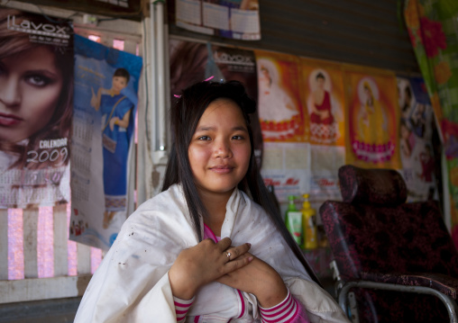 Teenager in a hairdresser, Pakse, Laos