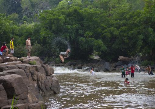 Kids jumping in tadfan waterfalls, Boloven, Laos