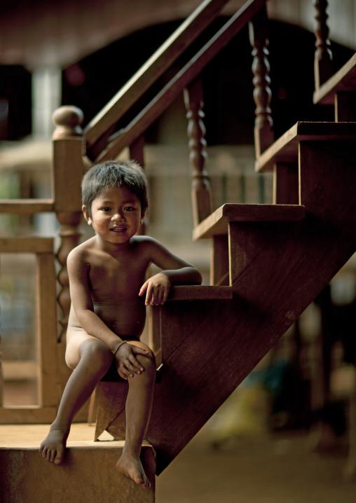 Bru kid sitting on stairs, Katou, Laos