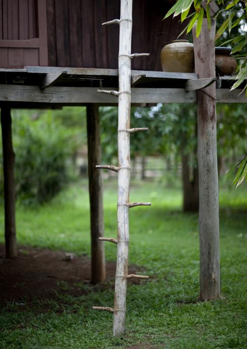 Ladder on a lavae minority house, Tadfan, Laos