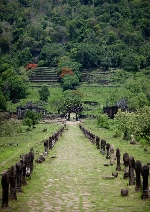 Raised stones lining lower level causeway leading to ancient khmer temple wat phu, Champasak, Laos