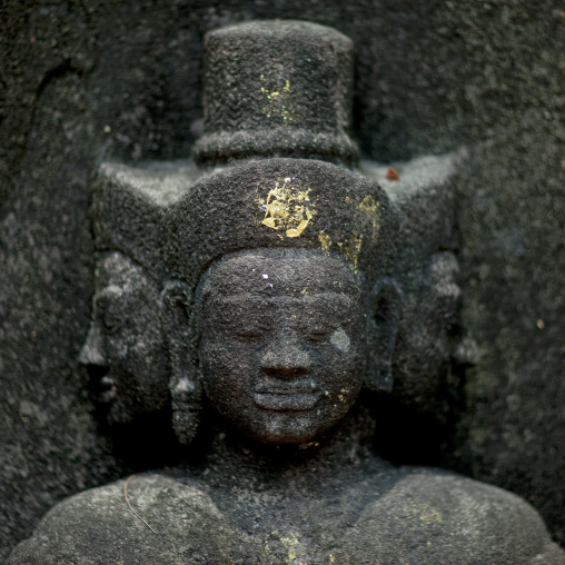 Statue guards temple at wat phu, Champasak, Laos