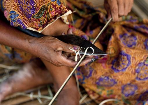 Bru minority woman cutting bamboos, Phonsaad, Laos