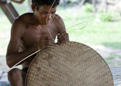 Bru minority man making a basket, Phonsaad, Laos