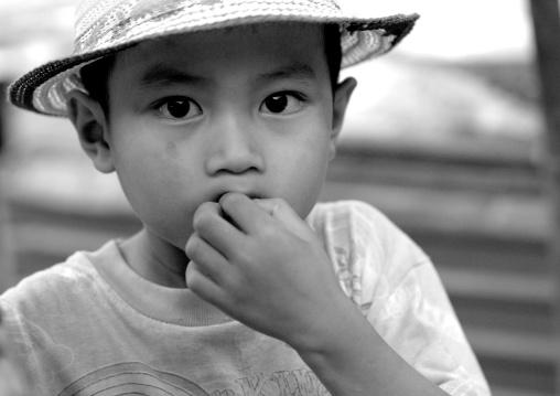 Lao boy with a hat, Pakse, Laos