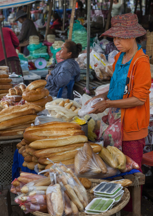 Woman selling french baguettes bread, Pakse, Laos