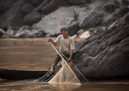 Fisherman on mekong river, Houei xay, Laos