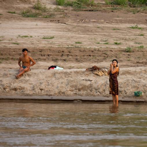 Laotian people taking bath on mekong river, Houei xay, Laos