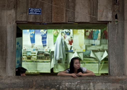 Girl at a window, Houei xay, Laos