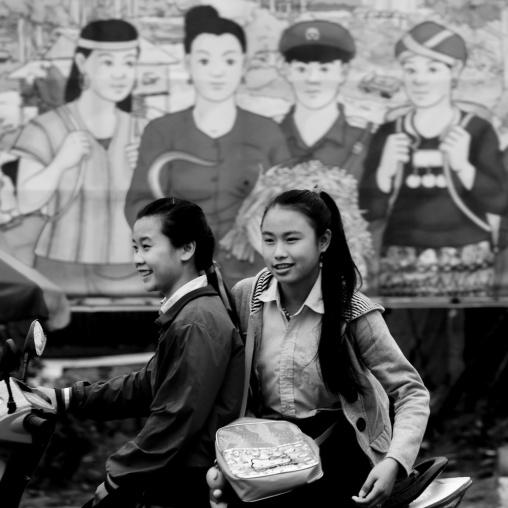 Khmu minority teenagers on a motorbike, Xieng khouang, Laos