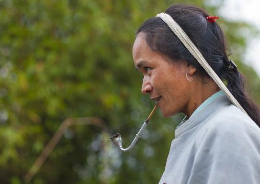 Khmu minority woman smoking pipe, Xieng khouang, Laos