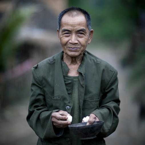 Khmu minority old man eating rice, Xieng khouang, Laos