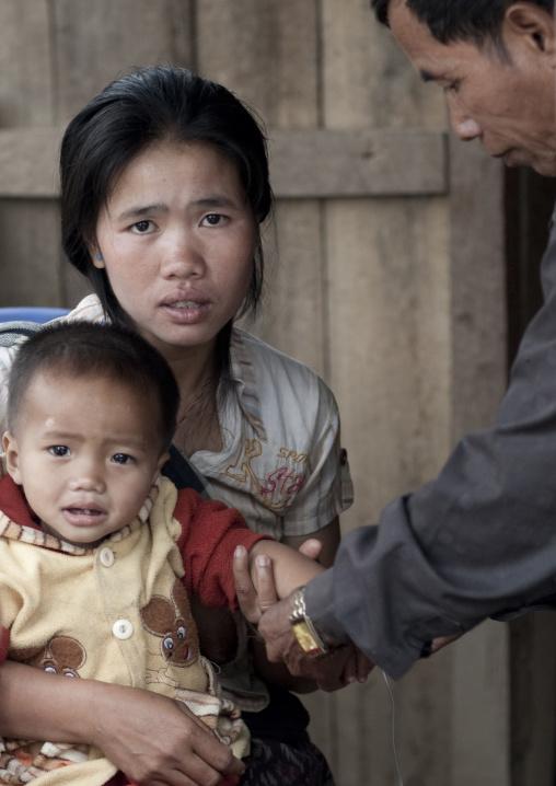 Khmu minority people at hospital, Xieng khouang, Laos