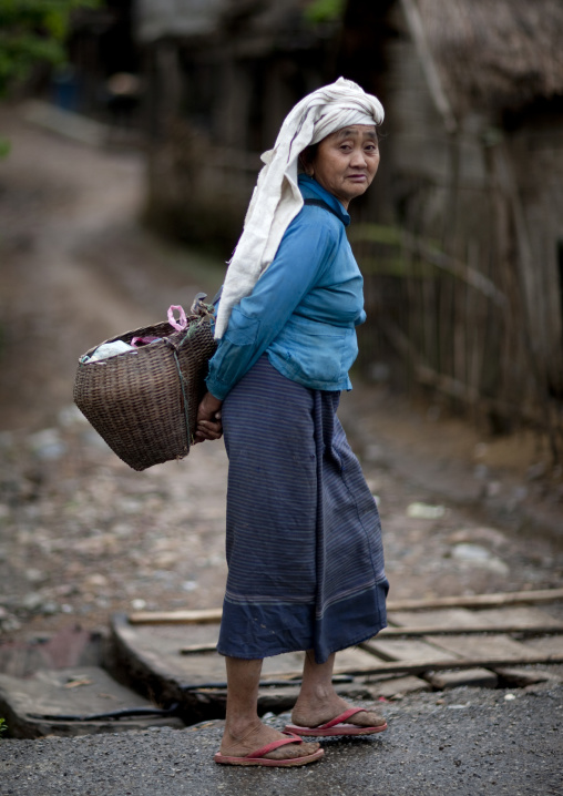 Thai kaho minority woman with a basket, Ban sam kang, Laos