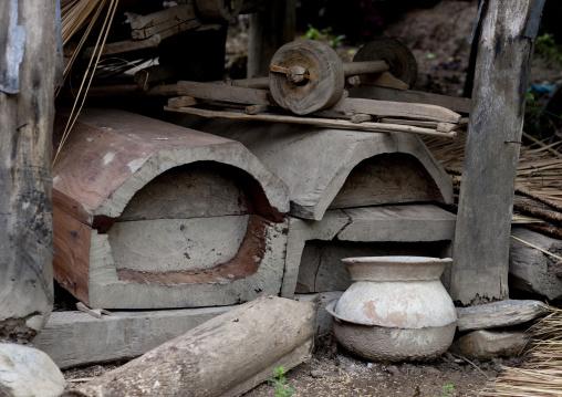 Thai kaho coffins under a house, Ban sam kang, Laos