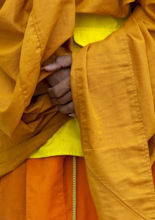 Buddhist monk hands, Nam deng, Laos