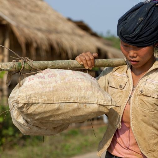 Woman carrying stuff, Luang namtha, Laos