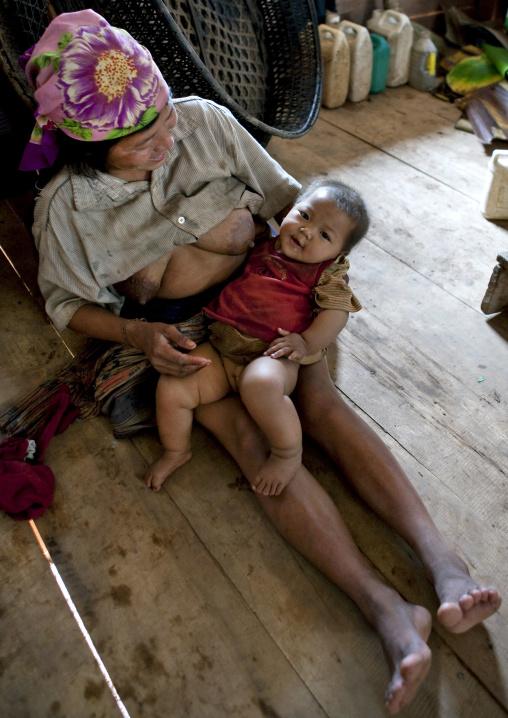 Akha minority breastfeeding mother and baby, Ban ta mi, Laos